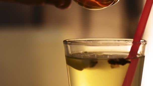 Pouring Natural Honey into Ginger Tea. Slow motion. HD