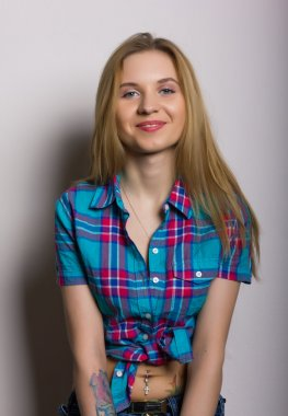 close-up portrait of sexy young girl in jeans and a plaid shirt