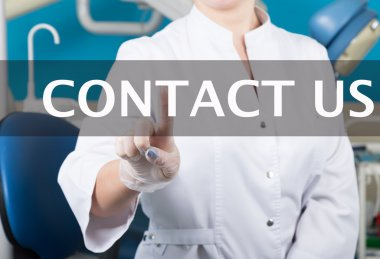 technology, internet and networking in medicine concept - medical doctor presses contact us button on virtual screens. Internet technologies in medicine