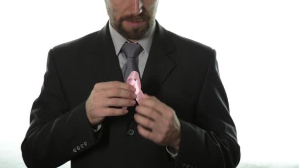 Close-up of man hands holding pink ribbon. breast cancer awareness. healthcare and medicine concept