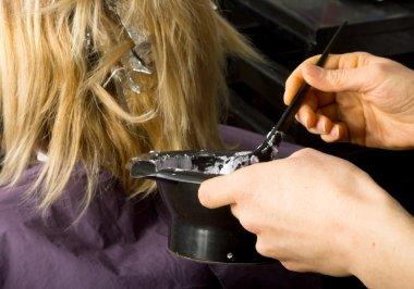 work of a professional hair stylist, hair bleach. hair coloring in a beauty salon