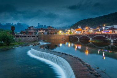 City by river in province of Hunan China