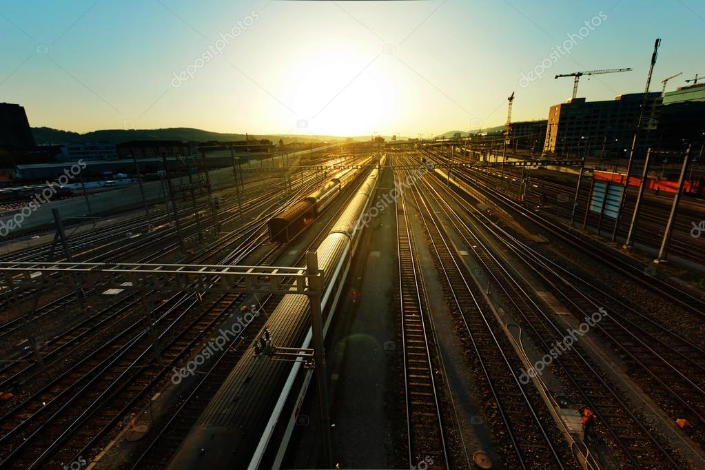 Railways with trains at evening