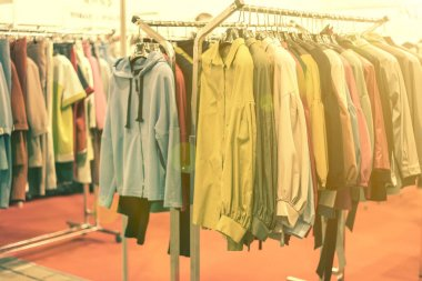 spring and summer womens clothing in the store. bright, modern clothes in a boutique. Womens hip clothing store interior concept. concept of choice of clothing. toned