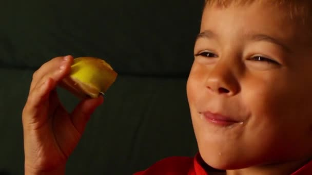 Boy eating sour apple and frowns