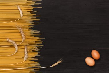 pasta for cooking, egg on wooden table