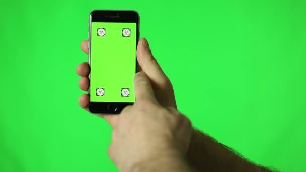 Smartphone Touchscreen Tap, Swipe e gesti di mano di diffusione sullo schermo verde