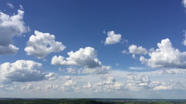 Loop of white clouds over blue sky with God Rays - time lapse