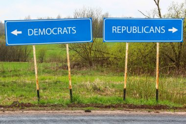 Republican and Democrat road sign with nature landscape in background