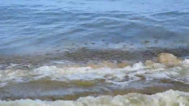 foamy sea water with waves