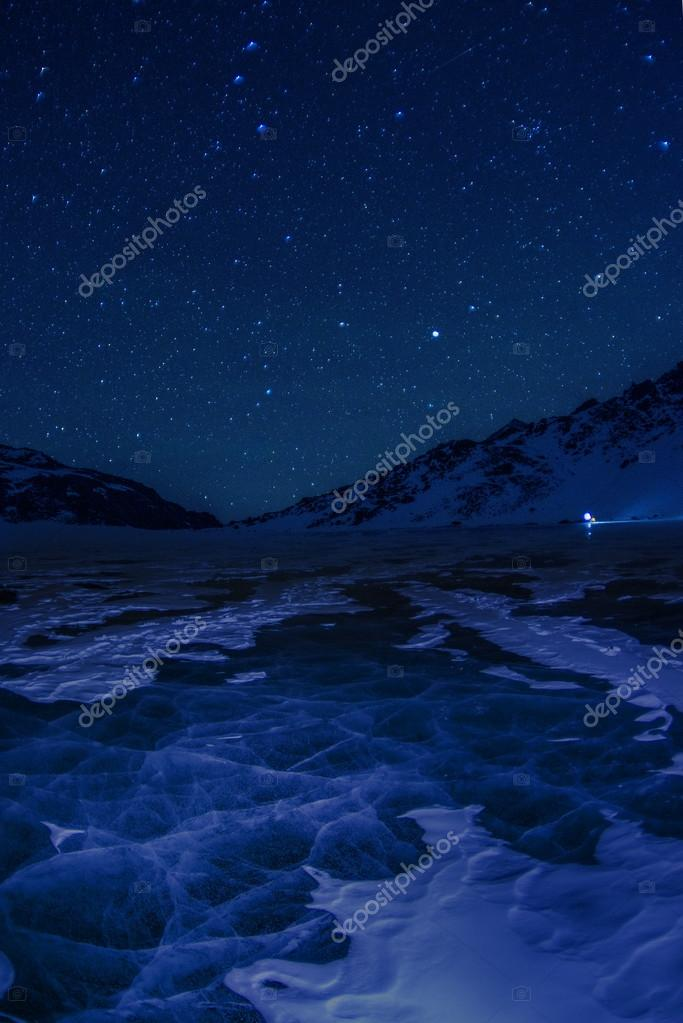 Bright stars above a winter lake Baikal.