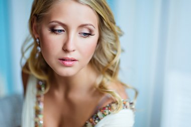 Portrait of a very beautiful blonde girl with blue eyes