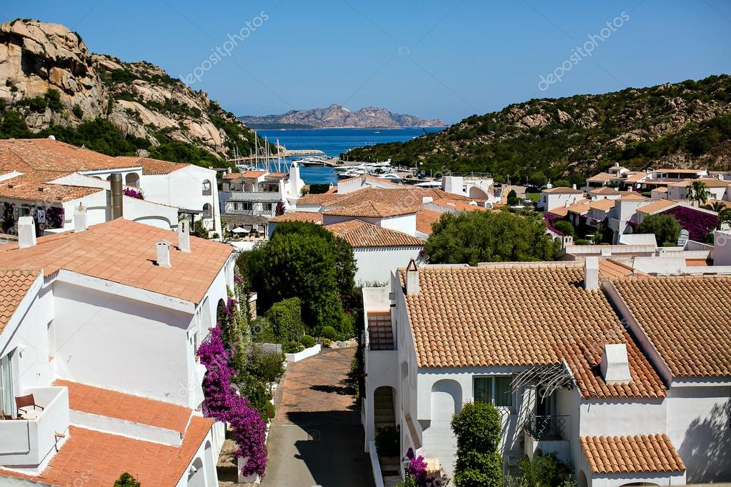 Landscape with rooftops and the sea in Sardinia