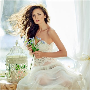 portrait of a sensual kinky girl in a white dress with hair flyi