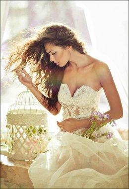 portrait of a sensual kinky girl in white dress in profile again