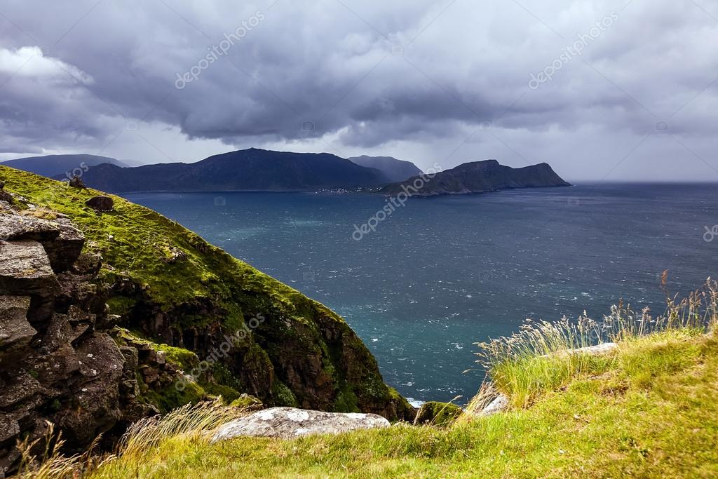 View from the bird cliffs on the ocean in windy weather in Norwa