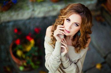 Portrait of a sensual kinky girl autumn background flowers, clos