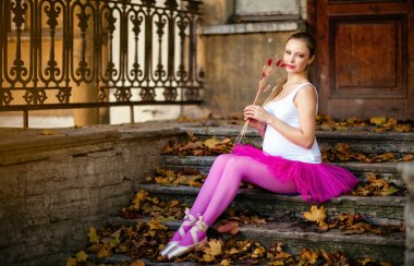 Portrait of a beautiful very cute pregnant girl in ballet pink t