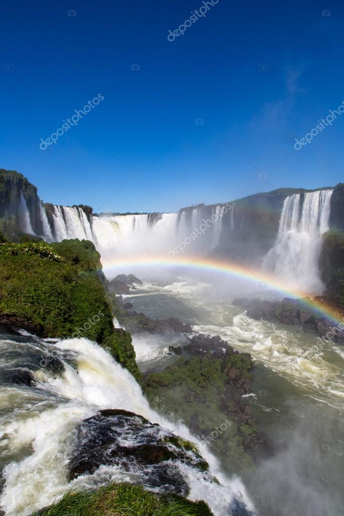 Beautiful Iguazu Falls with full rainbow