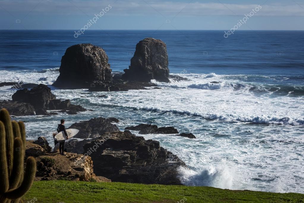 surfer on wild beach