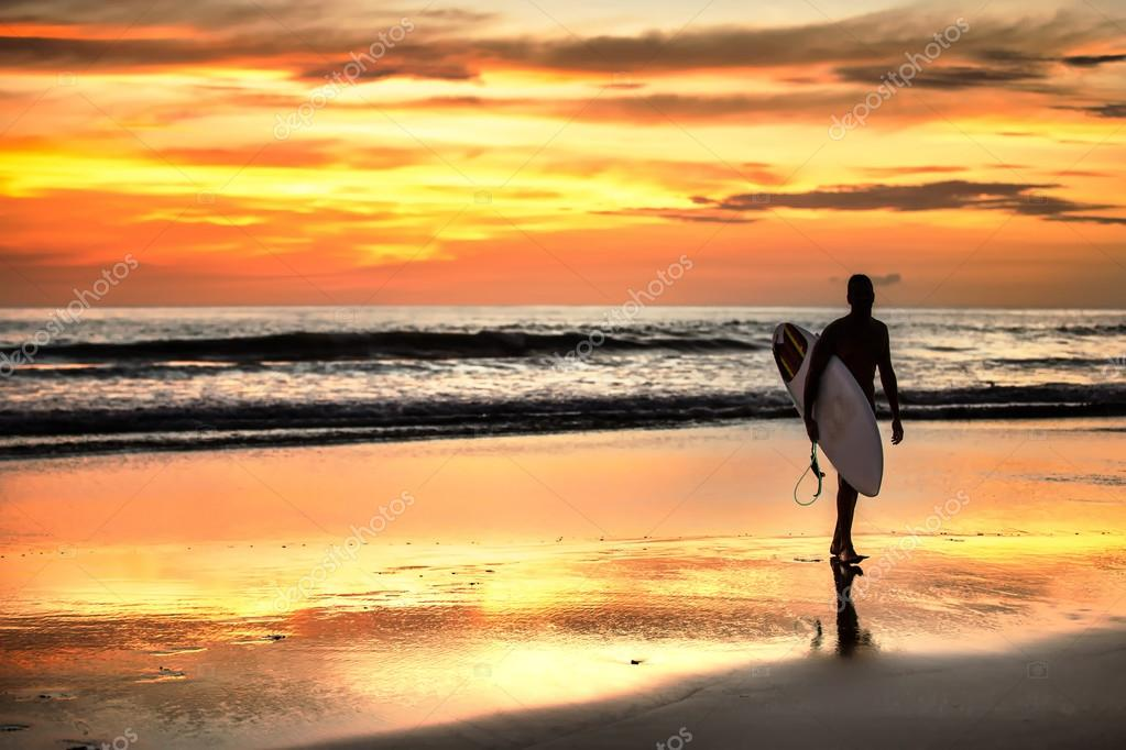 Surfer enjoying sunset in Playa Negra