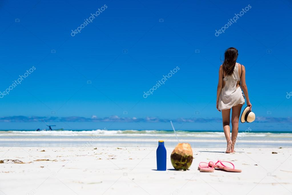woman with coconut and sunblock