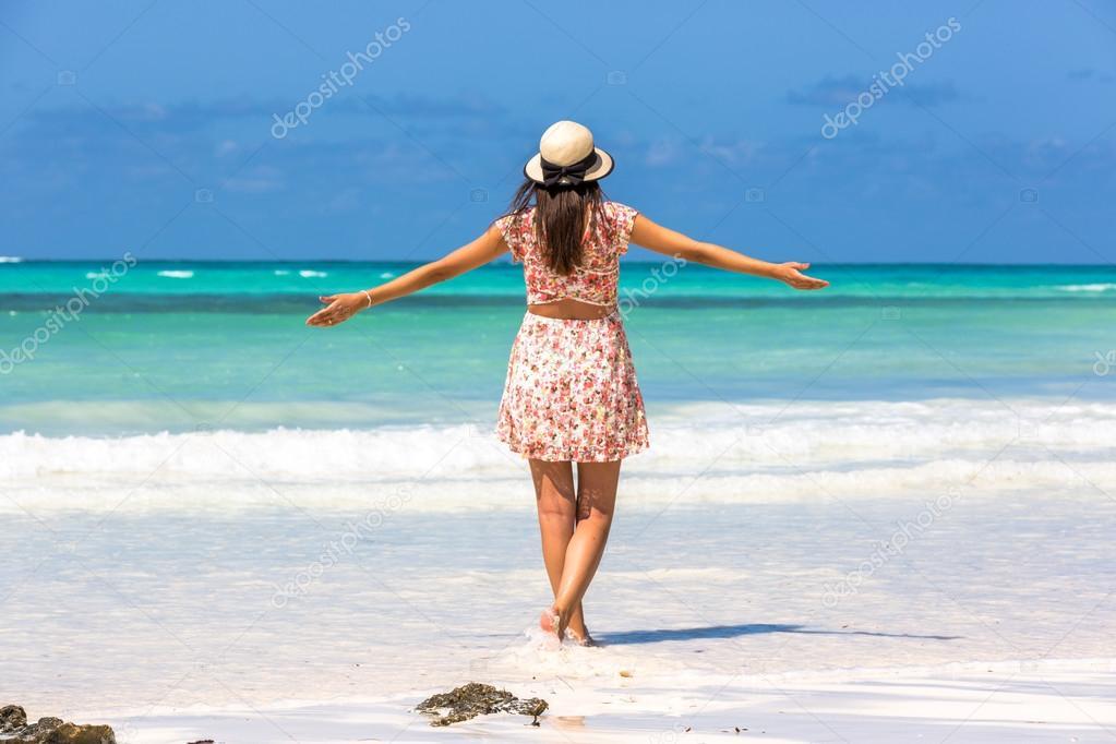 Woman enjoying beautiful beach