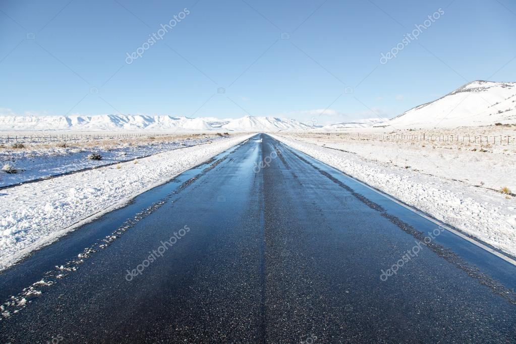 Empty road surrounded by snow