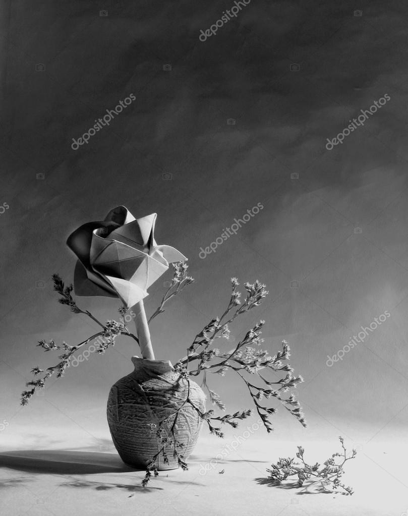 Beautiful still life with rose,vase of flowers on the white,grey,light background.Still life sith broken vase with brunches,flowers,paper rose on dark,grey,black wallpaper,background.Black and white still life with paper rose on wallpaper.