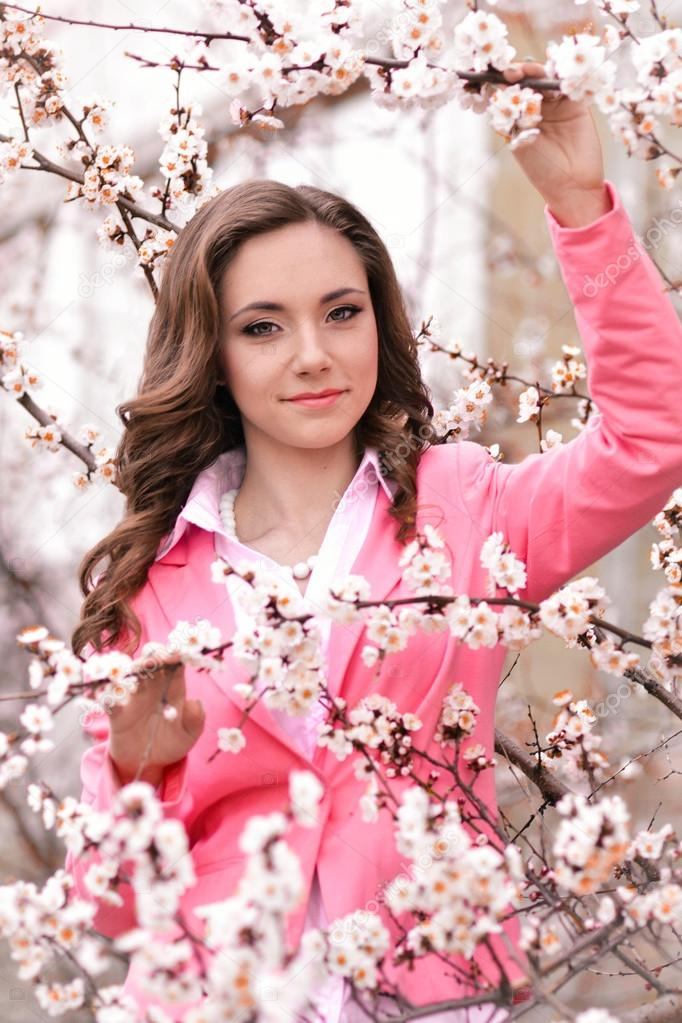 Very beautiful girl in blossoming trees in spring garden.Spring time ... 97bf8832c
