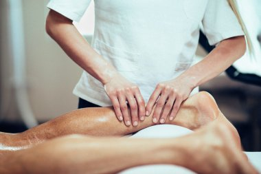 Massage therapist working with patient