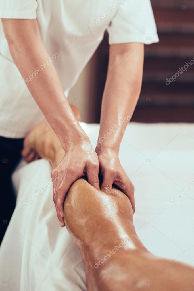 Physical therapist massaging leg
