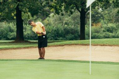 Golfer using chipping shot technique