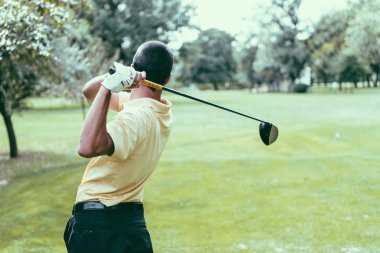 Golfer finishing his driver swing