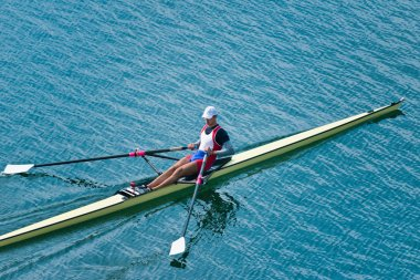 Man rowing single scull