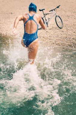 Female athlete triathlon training