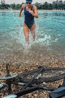 triathlete rushing out of the water