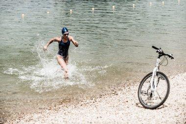 Triathlon training on the beach