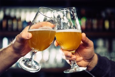 male hands with beer glasses