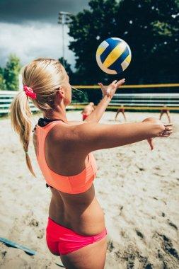 volleyball girl serving ball