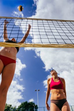 Girls playing beach volleyball