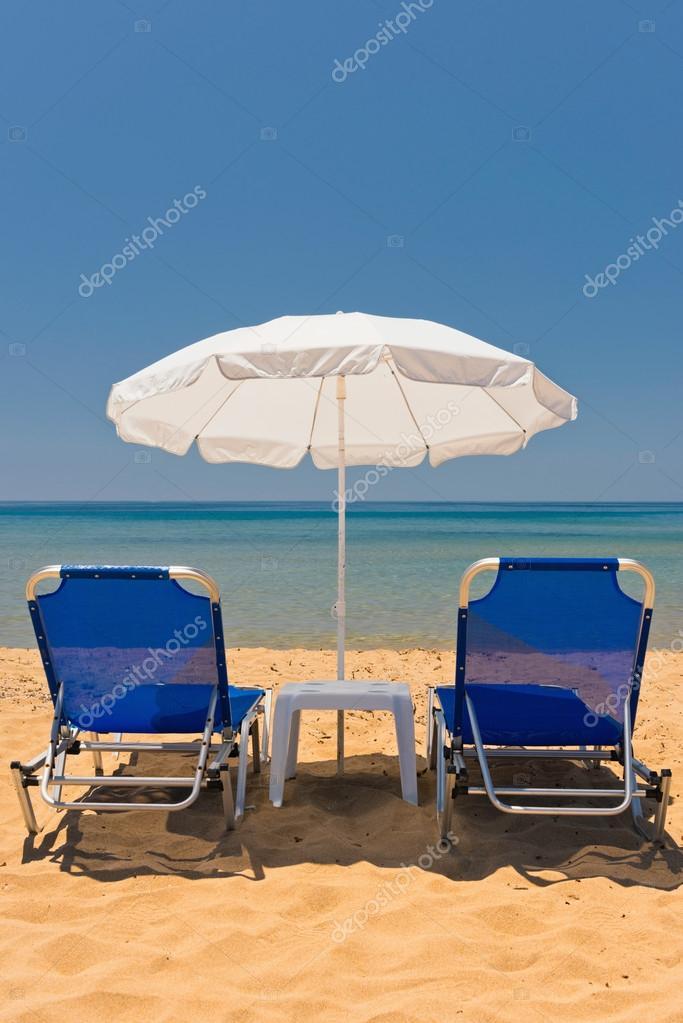 sandy beach with sun chairs