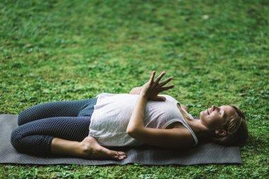 Woman Meditating with bent knees