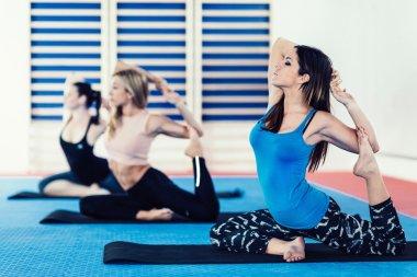 women in power yoga class