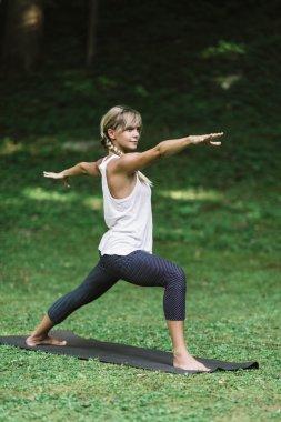 woman doing Warrior 2 pose
