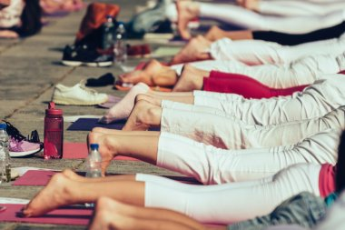 female legs on yoga class