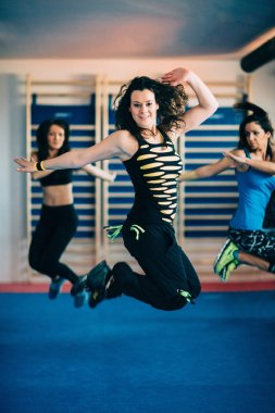 women jumping at Zumba fitness class