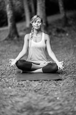relaxed young woman in lotus position
