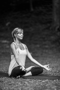 relaxed woman in lotus position