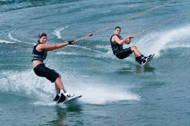 Young wakeboarding couple